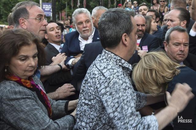Philippe Couillard a été agressé lors d'un rassemblement... (La Presse Canadienne)