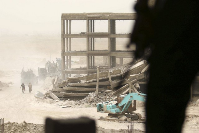 Les forces d'élite du contre-terrorisme circulent à Falloujah,... (PHOTO HAIDAR MOHAMMED ALI, AFP)