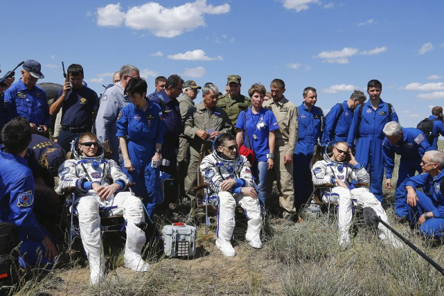 Le Britannique Tim Peake, le Russe Yuri Malenchenko... (AFP, Shamil Zhumatov)