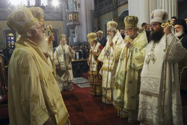 Dimanche, jour de la Pentecôte orthodoxe, le coup... (PHOTO COSTAS METAXAKIS, AFP)
