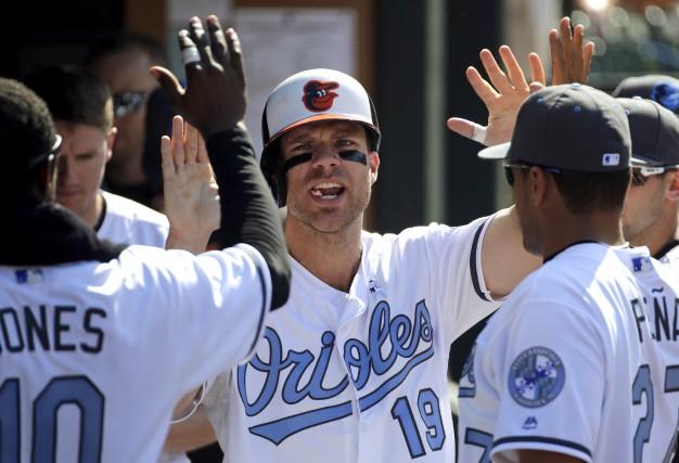 Chris Davis des Orioles a amassé trois coups... (AP, Patrick Semansky)
