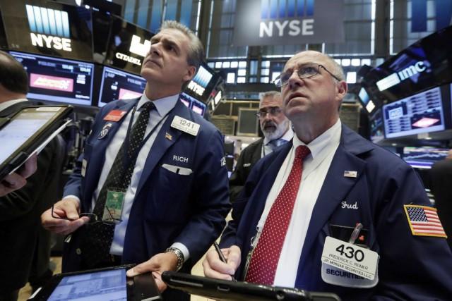 Comme l'ensemble des marchés mondiaux, Wall Street a monté lundi grâce à... (Photo Richard Drew, AP)