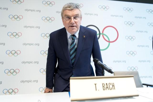 Le président du CIO, Thomas Bach, s'est attardé... (AP, Laurent Gillieron)