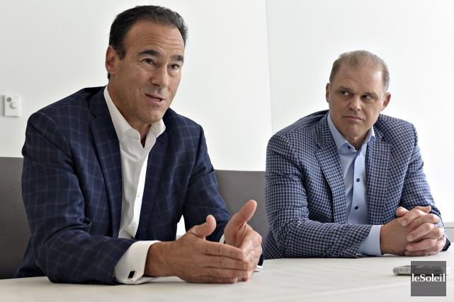 Pierre Dion, chef de direction de Québecor,et Benoît... (Photothèque Le Soleil)