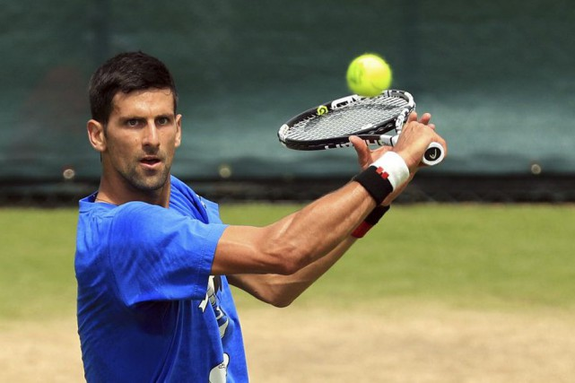 Novak Djokovic... (PHOTO ADAM DAVY, AP/PA)