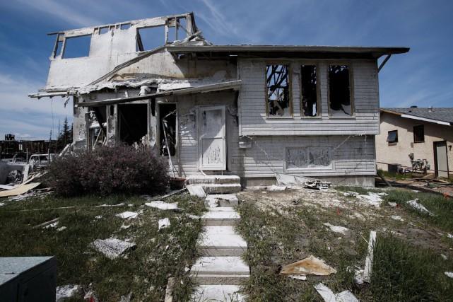 Une maison de Fort McMurray ravagée par le... (Photo archives La Presse Canadienne)