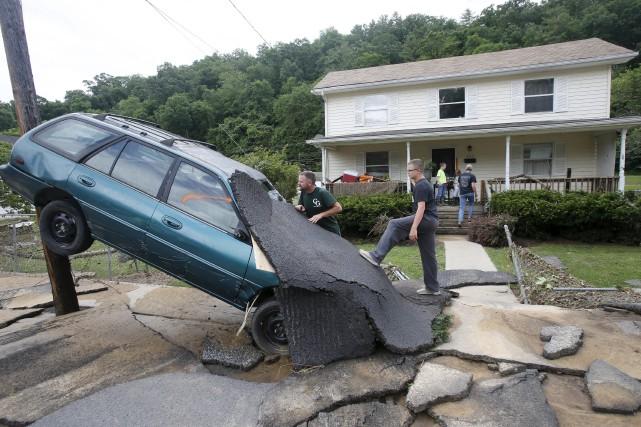 De gros orages et des pluies torrentielles, notamment... (AP, Steve Helber)