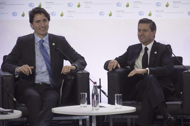 Le premier ministre canadien, Justin Trudeau, et le... (La Presse Canadienne, Adrian Wyld)