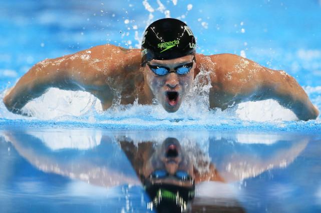 Cinq fois champion olympique, Ryan Lochte devra travailler... (AP, Orlin Wagner)