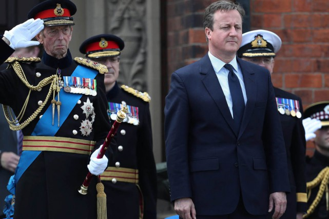 David Cameron... (PHOTO Peter Byrne, AP)