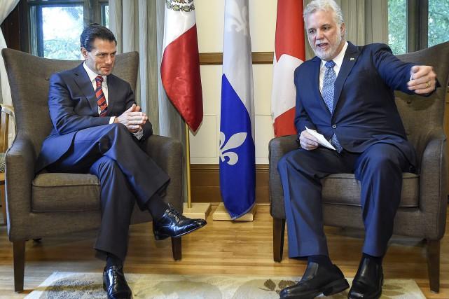 Enrique Peña Nieto et Philippe Couillardont rappelé la... (Pool médiatique, Simon Clark)