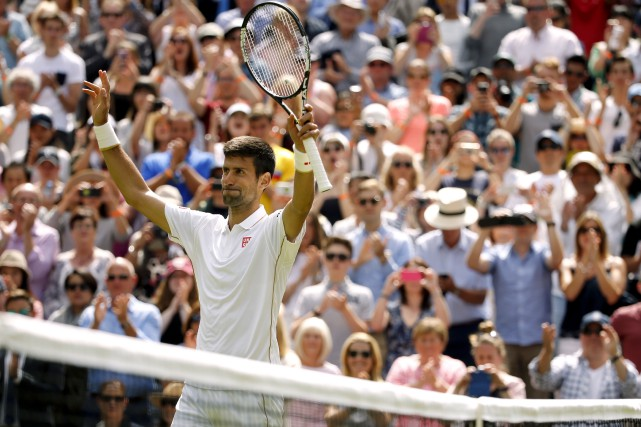 Le Serbe Novak Djokovic a battu le Britannique... (AP, Alastair Grant)