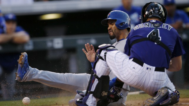 Les Rockies du Colorado ont battu les Blue... (Associated Press)