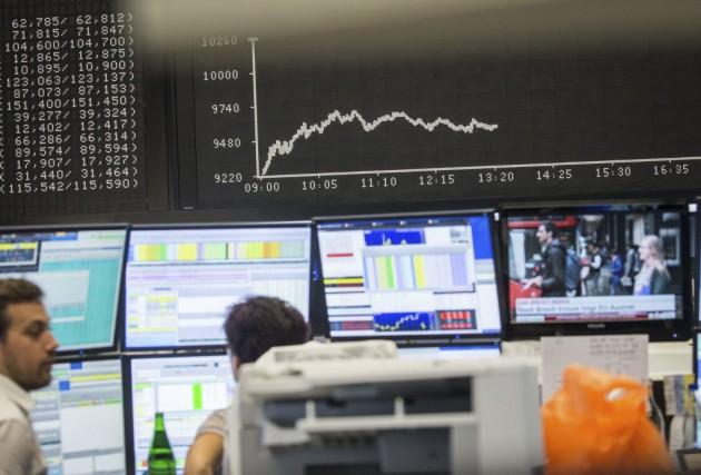 Après deux séances particulièrement calamiteuses, les marchés européens... (Photo Frank Rumpenhorst, AP)