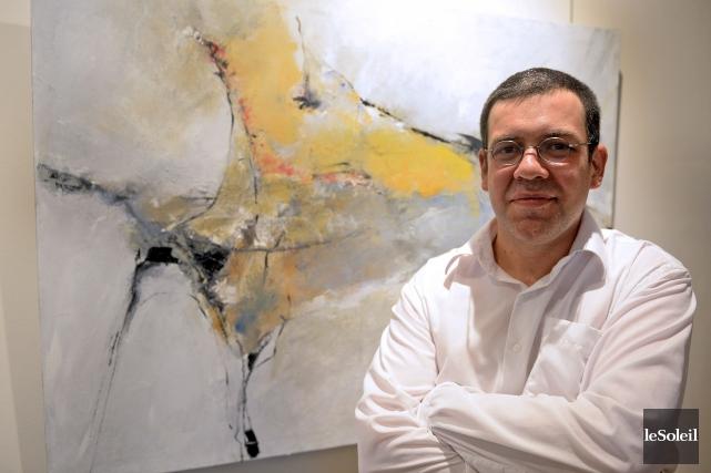Benoit Genest Rouillier devant son tableau Le miracle.... (Le Soleil, Erick Labbé)