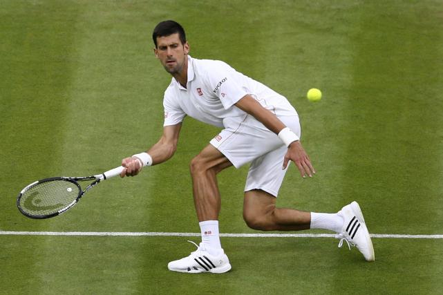Novak Djokovic a signé une 30e victoire d'affilée... (Photo Justin Tallis, AFP)