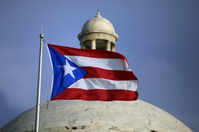 Autrefois prospère, l'île de 3,5 millions d'habitants a... (ARCHIVES AP)