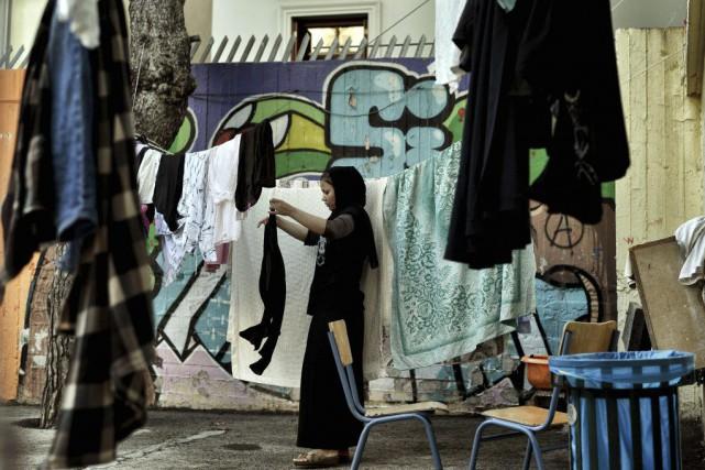 Les familles de réfugiés, majoritairement syriens et afghans,... (PHOTO ARIS MESSINIS, AFP)
