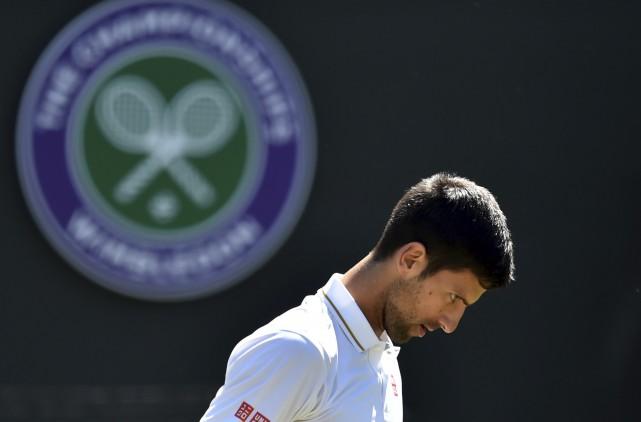 La dernière élimination aussi hâtive de Novak Djokovic... (AFP, Glyn Kirk)
