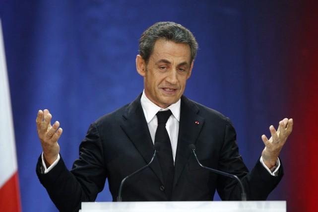 Nicolas Sarkozy, qui a dû concéder la victoire... (Archives AP, Michel Spingler)