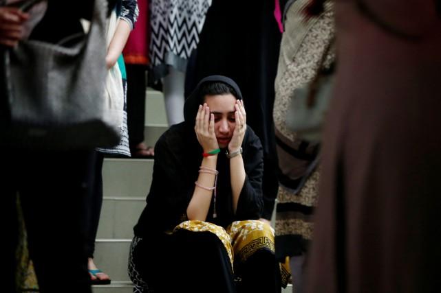 Une proche d'une des victimes de la tuerie... (PHOTO Adnan Abidi, REUTERS)