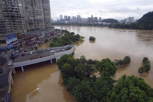 Les inondations sont fréquentes dans le sud de... (AFP)