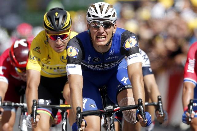 Marcel Kittel a remporé sa neuvième victoire d'étape... (AP, Christophe Ena)