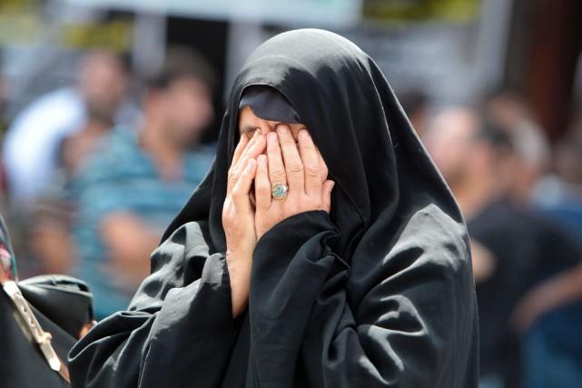 L'attentat a provoqué la colère des Irakiens face... (PHOTO SABAH ARAR, AFP)