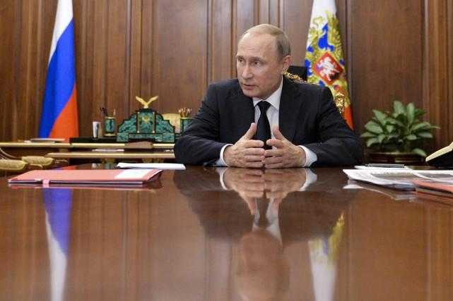 Le président russe Vladimir Poutine... (PHOTO Alexei Druzhinin, SPUTNIK/KREMLIN/AP)