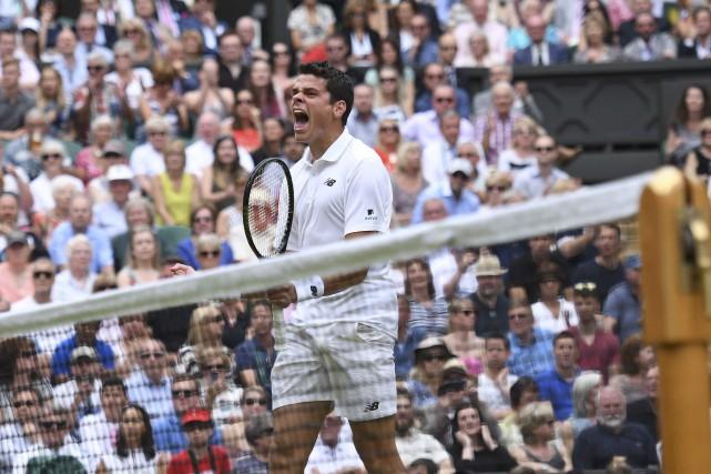 Milos Raonic a crié sa joie après être... (AFP, Leon Neal)