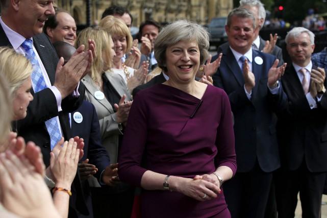 La ministre de l'Intérieur Theresa May... (AP, Jonathan Brady)