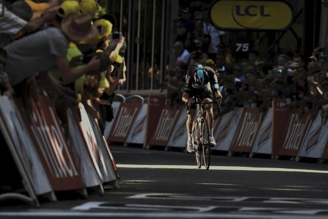 Le Britannique Chris Froome, champion défendant du Tour... (AP, Christophe Ena)