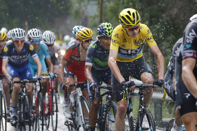 Le Britannique Chris Froome est toujours le maillot... (Archives, Associated Press)