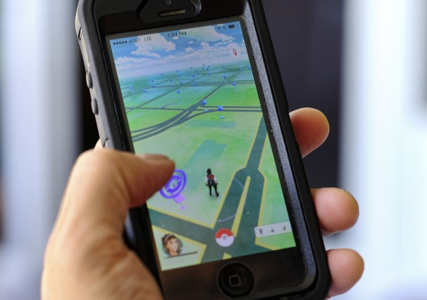 Pokemon Go is displayed on a cell phone... (Photo AP)
