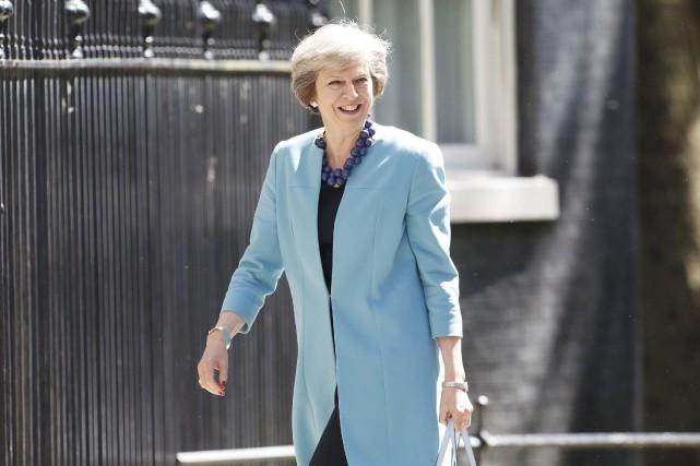 Investie première ministre mercredi moins de trois semaines... (Photo Paul Hackett, REUTERS)
