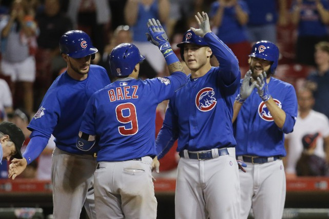 Les Cubs de Chicago détiennent sept matchs d'avance... (Photo John Minchillo, AP)