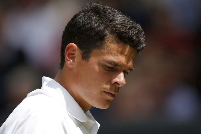 Milos Raonic... (AFP, Andrew Couldridge)