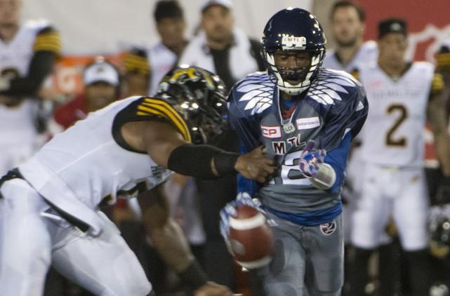 Adrian Tracy (Tiger-Cats) etRakeem Cato (Alouettes).... (La Presse Canadienne)