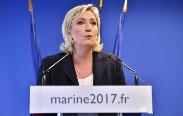 Marine Le Pen, qui est à la tête du parti d'extrême droite français Front... (AFP, Alain Jocard)