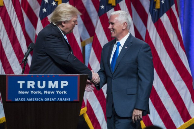 Donald Trump et Mike Pence, samedi à New... (Photo Evan Vucci, AP)