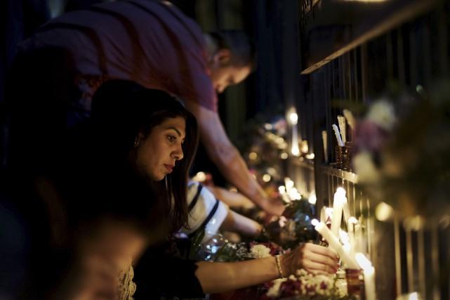 84 personnes, dont dix enfants et adolescents, ont... (Agence France-Presse)