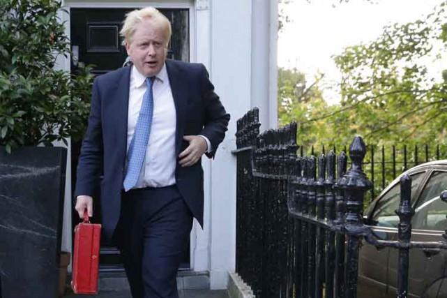 La nomination par la nouvelle première ministre Theresa... (PHOTO AFP)