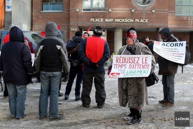 Des représentants de l'organisme ACORN, lors d'une manifestation... (Patrick Woodbury, Archives LeDroit)