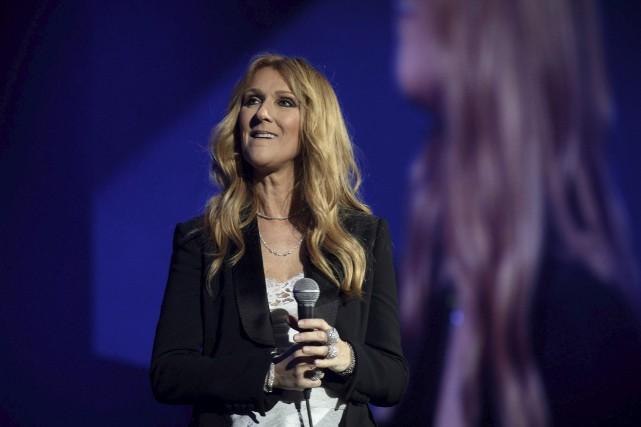 Céline Dion, à Paris.... (AFP, PHILIPPE LOPEZ)