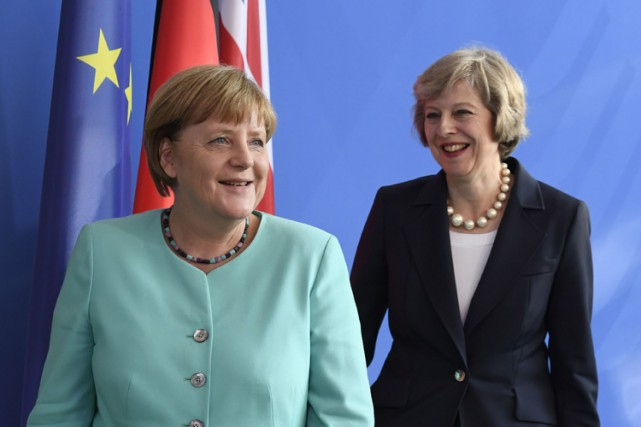 Angela Merkel et Theresa May ont participé mercredi... (PHOTO AFP)