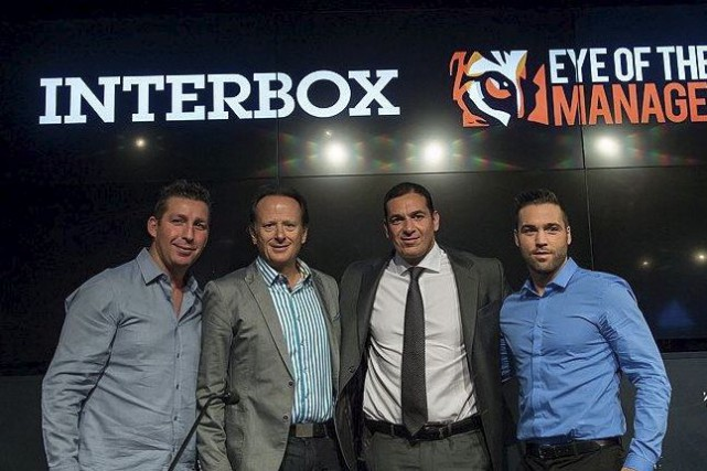 Éric Lucas et Jean Bédard, d'Interbox, en compagnie... (Eye of the Tiger Management)