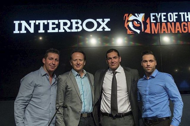 Éric Lucas et Jean Bédard, d'Interbox, en compagnie... (Courtoisie)