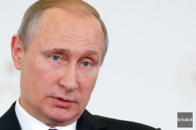 Le président russe Vladimir Poutine... (Photothèque Le Soleil, AP, Alexander Zemlianichenko)