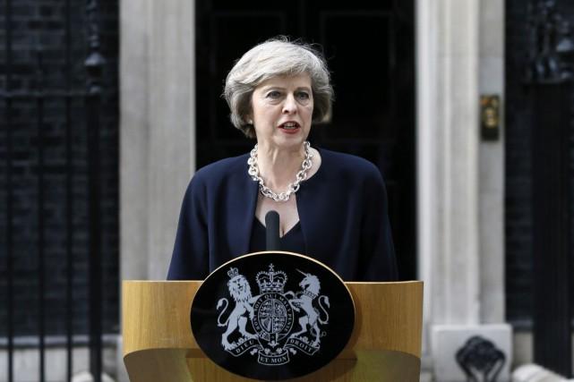 La première ministre a assuré que son gouvernement... (Archives AP, Kirsty Wigglesworth)