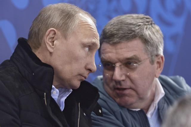 Le président russe, Vladimir Poutine, et le président... (Archives AP, Alexei Nikolsky)